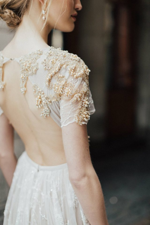 A-line backless wedding dress ESTER with gold luxury embroidery and long train by KurajeWeddingDresses